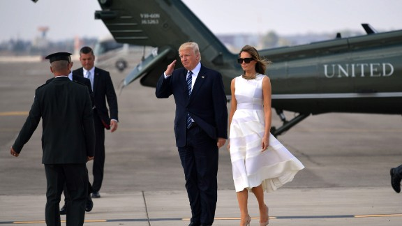 US President Donald Trump and First Lady Melania Trump make their way to board Air Force One before departing from Ben Gurion International Airport in Tel Aviv on May 23, 2017.