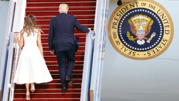 US President Donald Trump (R) and his wife, First Lady Melania Trump, board Air Force One from Ben Gurion International Airport in Tel Aviv on May 23, 2017, bound for Rome.
