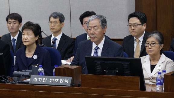 Former South Korean President Park Geun-hye (L) sits with her longtime friend Choi Soon-sil (R) for her trial at the Seoul Central District Court on May 23, 2017 in Seoul, South Korea.