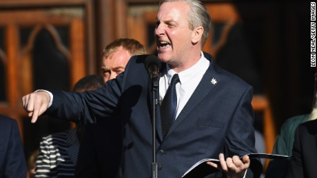MANCHESTER, ENGLAND - MAY 23: Poet Tony Walsh speaks as members of the public gather at a vigil, to honour the victims of Monday evening's terror attack, at Albert Square on May 23, 2017 in Manchester, England. Monday's explosion occurred at Manchester Arena as concert goers were leaving the venue after Ariana Grande had just finished performing. Greater Manchester Police are treating the explosion as a terrorist attack and have confirmed 22 fatalities and 59 injured.  (Photo by Leon Neal/Getty Images)