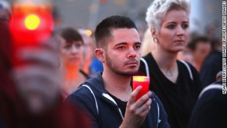 BERLIN, GERMANY - JUNE 18:  Mourners attend a vigil for victims of a shooting at a gay nightclub in Orlando, Florida nearly a week earlier, in front of the United States embassy on June 18, 2016 in Berlin, Germany. Fifty people were killed and at least as many injured during a Latin music event at the Pulse club in the worst terror attack in the U.S. since 9/11. The American-born gunman had pledged allegiance to ISIS, though officials have yet to find conclusive evidence of his having any direct connection with foreign extremists. The incident has added fuel to the ongoing debate about gun control in the country.  (Photo by Adam Berry/Getty Images)