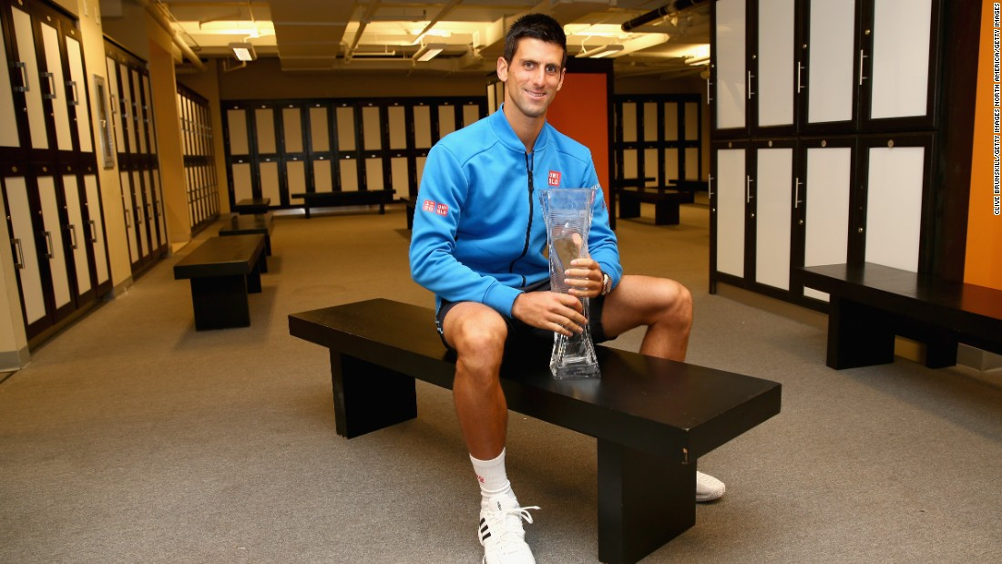 As well as a place of preparation for matches, locker rooms are also a perfect setting for posing for photos after winning trophies. Novak Djokovic is pictured holding the Butch Bucholz trophy after winning his fifth Miami Open title in 2015.