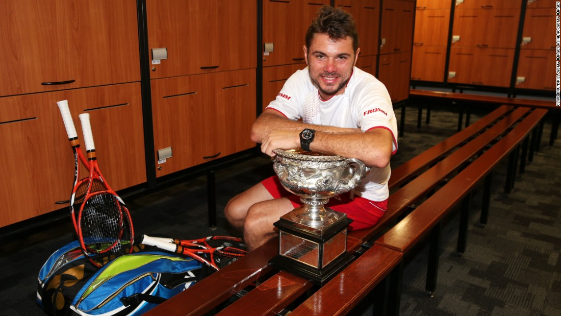 Stanislas Wawrinka of Switzerland is pictured posing with the Norman Brookes Challenge Cup in the players' dressing room after winning his men's final match against Nadal of Spain at the 2014 Australian Open at Melbourne Park.
