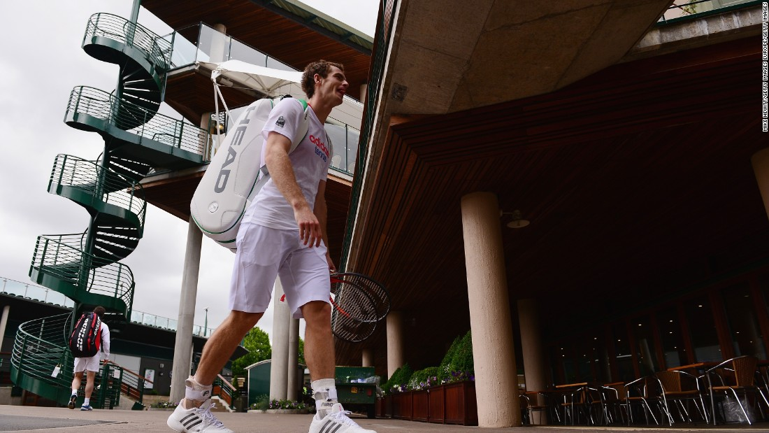 Britain's Andy Murray heads back to the locker room after finishing a practice session at Wimbledon.