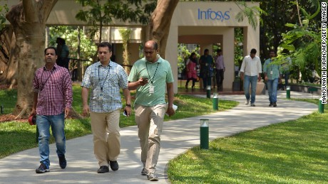 Employees on the Bangalore, India, campus of Infosys, a tech giant that is one of the top recipients of H-1B visas.