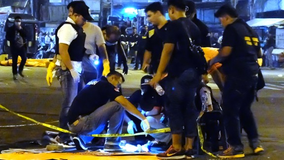 Police investigate a body part found after suicide bombers struck a Jakarta bus station Wednesday.