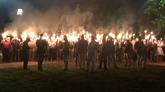 A group of torch-wielding protesters gathered in May at a Charlottesville, Virginia park recently to protest the planned removal of a statue Gen. Robert E. Lee, a Confederate Civil War hero.