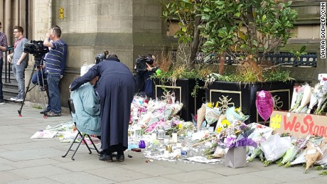 Patel comforted Black as she began to cry at the temporary memorial.