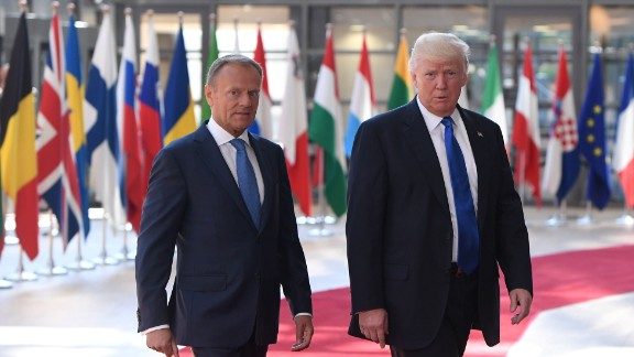 European Council President Donald Tusk (L) welcomes US President Donald Trump (R) at EU headquarters, as part of the NATO meeting, in Brussels, on May 25, 2017. / AFP PHOTO / Emmanuel DUNANDEMMANUEL DUNAND/AFP/Getty Images