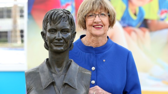 Margaret Court poses with a bronze bust of herself during the 2015 Australian Open at Melbourne Park.