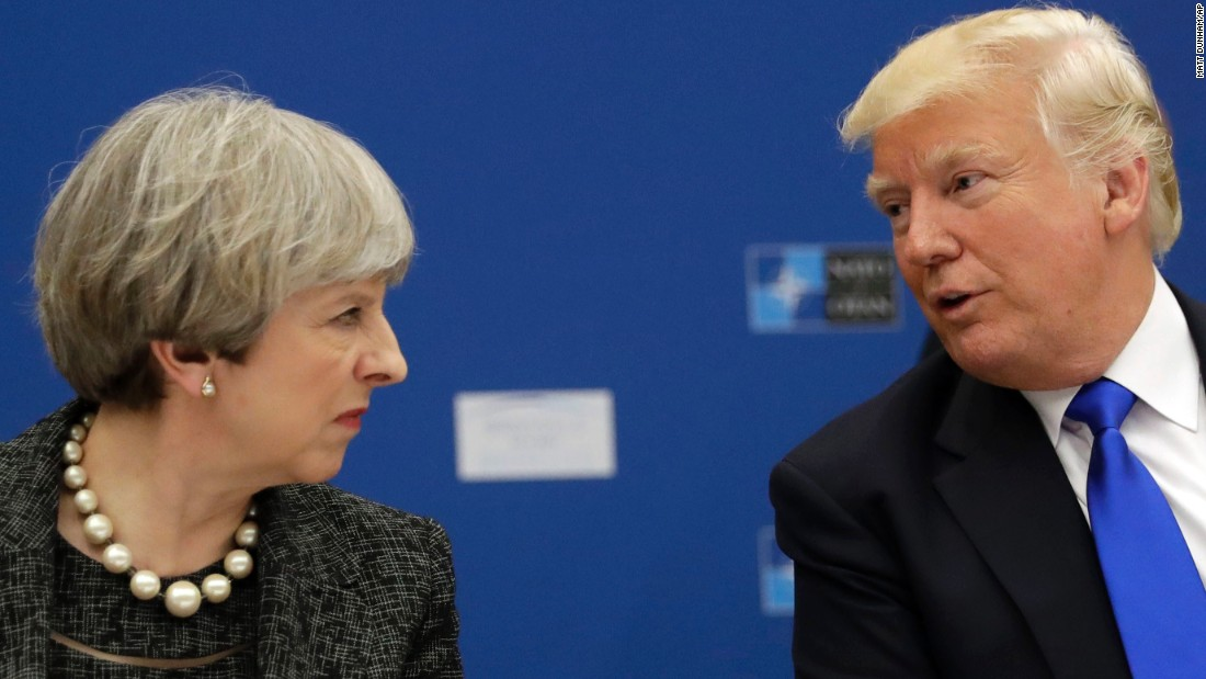 Trump speaks with British Prime Minister Theresa May during a working dinner at NATO headquarters.