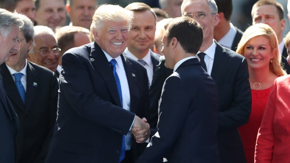 Trump shakes hands with Macron in Brussels, Belgium, on Thursday, May 25. They were attending a NATO summit as the alliance officially opened a new $1 billion headquarters.