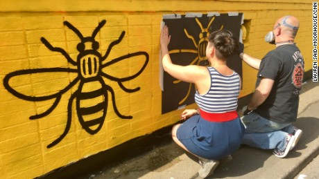 "New murals adorn the walls of the Outhouse in central Manchester's Stevenson Square. Project organizer Tasha Whittle told CNN the artists wanted to ""show a message of positivity."""