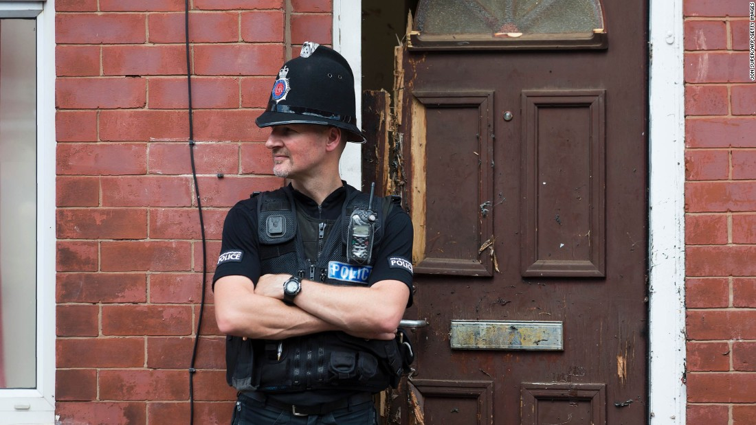 "A police officer guards a house in Manchester as investigations continued on May 25. Police say a man carrying explosives <a href=""http://www.cnn.com/2017/05/23/europe/manchester-terror-attack-uk/index.html"" target=""_blank"">acted as a lone attacker</a> and died in the blast."