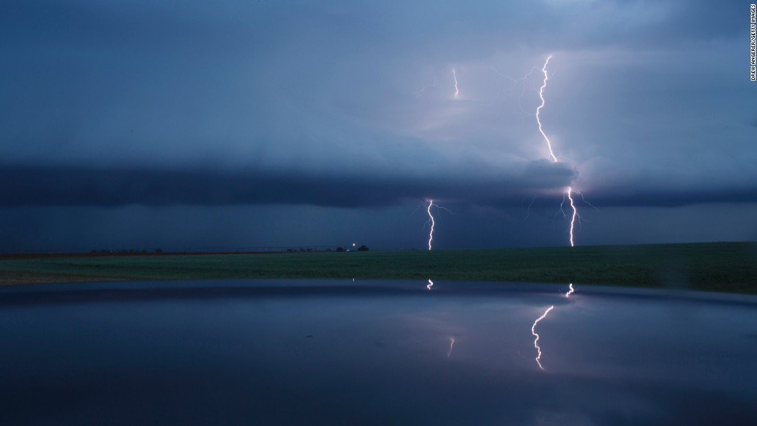 <strong>Lamb County, Texas: </strong>This dramatic image captures cloud-to-ground lightning strikes during a supercell thunderstorm on May 9, 2017.