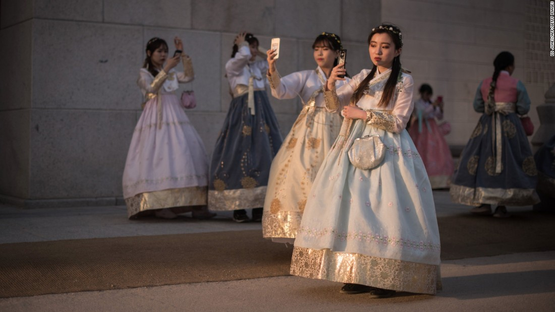 <strong>Seoul: </strong>A group of South Korean women wearing traditional hanbok dresses take selfies outside Gyeongbokgung palace in Seoul.