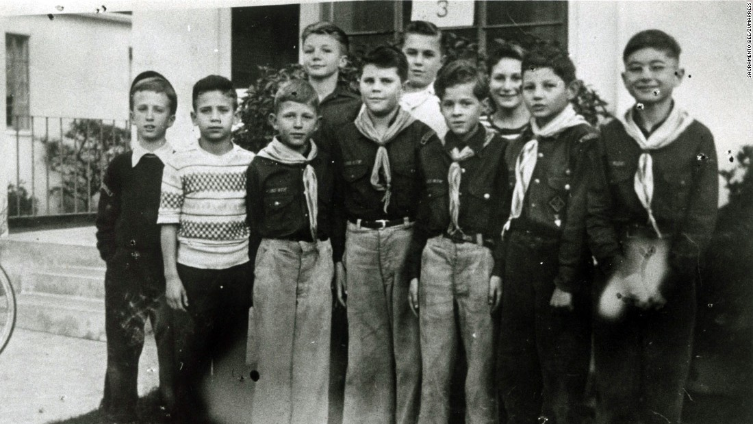 Kennedy, third from right in the front row, stands with other Cub Scouts in the 1940s.
