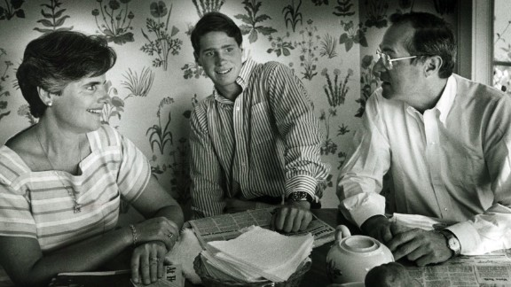 Kennedy has breakfast with his wife, Mary, and his son Gregory in 1984.