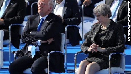 US President Donald Trump (L) and British Prime Minister Theresa May (R)  a ceremony at the NATO (North Atlantic Treaty Organization) summit at the NATO headquarters, in Brussels, on May 25, 2017.  / AFP PHOTO / POOL / Dan KitwoodDAN KITWOOD/AFP/Getty Images