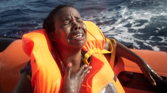 A woman cries after losing her baby in the water.