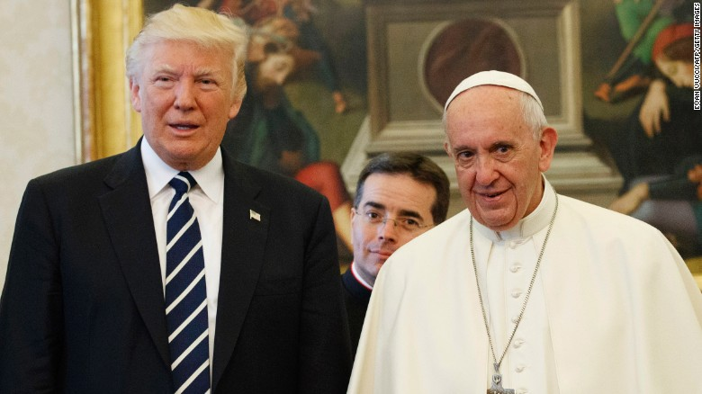 Pope Francis (R) stands with US President Donald Trump during a private audience at the Vatican on May 24, 2017.