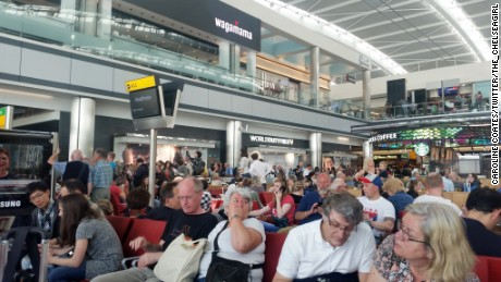 Passengers wait Saturday at London's Heathrow Airport as British Airways experiences computer problems.