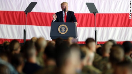 President Donald Trump addresses U.S. military troops and their families at the Sigonella Naval Air Station, in Sigonella, Italy, Saturday, May 27, 2017.