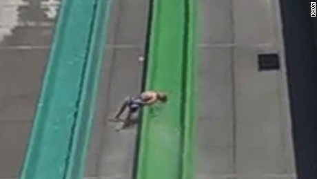 Boy falls off water slide