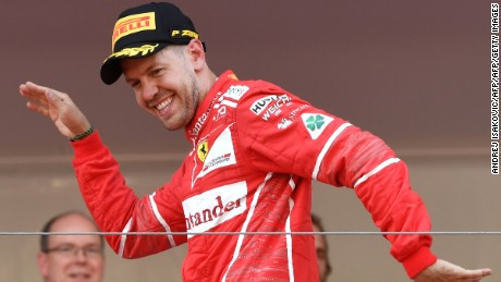 Sebastian Vettel celebrates on the podium after winning the 2017 Monaco Formula 1 Grand Prix.
