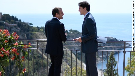 Canadian Prime Minister Justin Trudeau, right, and French President Emmanuel Macron talk in May.