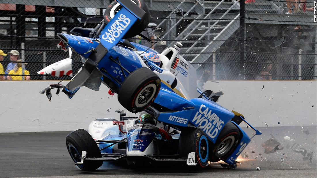 "Scott Dixon's car goes over Jay Howard's during a crash at <a href=""http://www.cnn.com/2017/05/28/sport/indianapolis-500/"" target=""_blank"">the Indianapolis 500</a> on Sunday, May 28. Howard had clipped the wall and bounced into Dixon, sending him airborne with flames firing out the back of the car. Neither driver was injured."