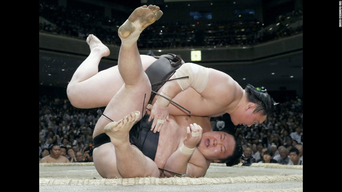 Grand champion Hakuho, top, defeats Goeido at a sumo tournament in Tokyo on Wednesday, May 24.