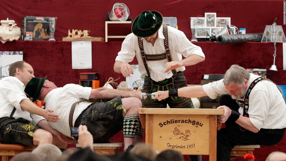 A man tries to pull his opponent over the table during a finger-wrestling match Thursday, May 25, at the Alpine Country Championships in Wornsmuhl, Germany.