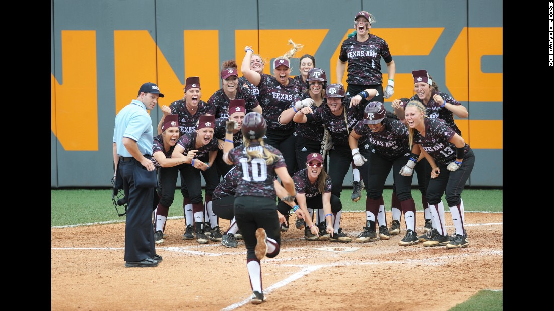Teammates wait on Texas A&M's Riley Sartain after she hit a home run against Tennessee in their NCAA softball game on Sunday, May 28. Texas A&M won the game to advance to the College World Series.