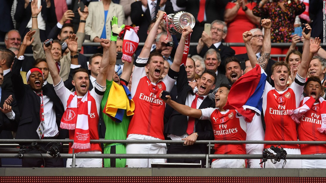 Arsenal defender Per Mertesacker lifts the FA Cup after a 2-1 victory over Chelsea on Saturday, May 27. Arsenal has won England's premier cup competition a record 13 times.