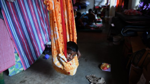 A young Sri Lankan flood victim rests at a relief camp after being evacuated following flooding in the suburb of Kaduwela in the capital Colombo.