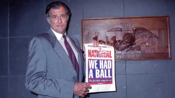 Frank Deford, a renowned sportswriter and commentator, died May 28 at the age of 78. Here, Deford holds the final front page of The National Sports Daily when it folded in 1991. Deford was well known for his NPR commentaries as well as his decades-long career at Sports Illustrated.