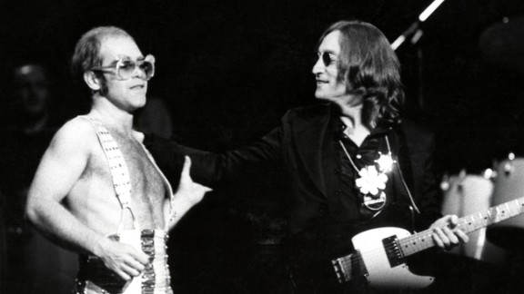 John appears on stage with John Lennon at New York's Madison Square Garden in 1974.