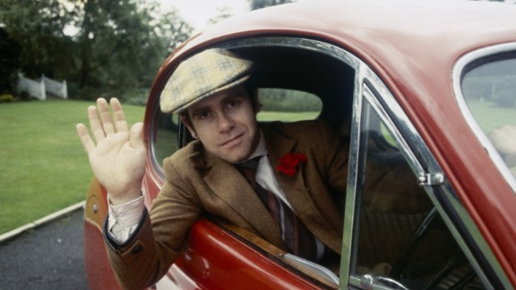 John waves from his car in 1978.