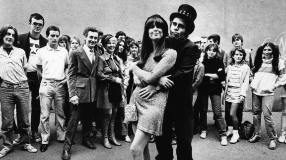 """Fans watch John embrace singer and friend Kiki Dee in 1978. The two had a No. 1 hit, """"Don't Go Breaking My Heart,"""" in 1976."""
