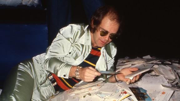 John reads some fan mail circa 1975.