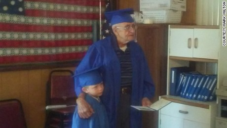 Milton Mockerman, right, finally received his high school diploma -- about 71 years after he should have been done with school.