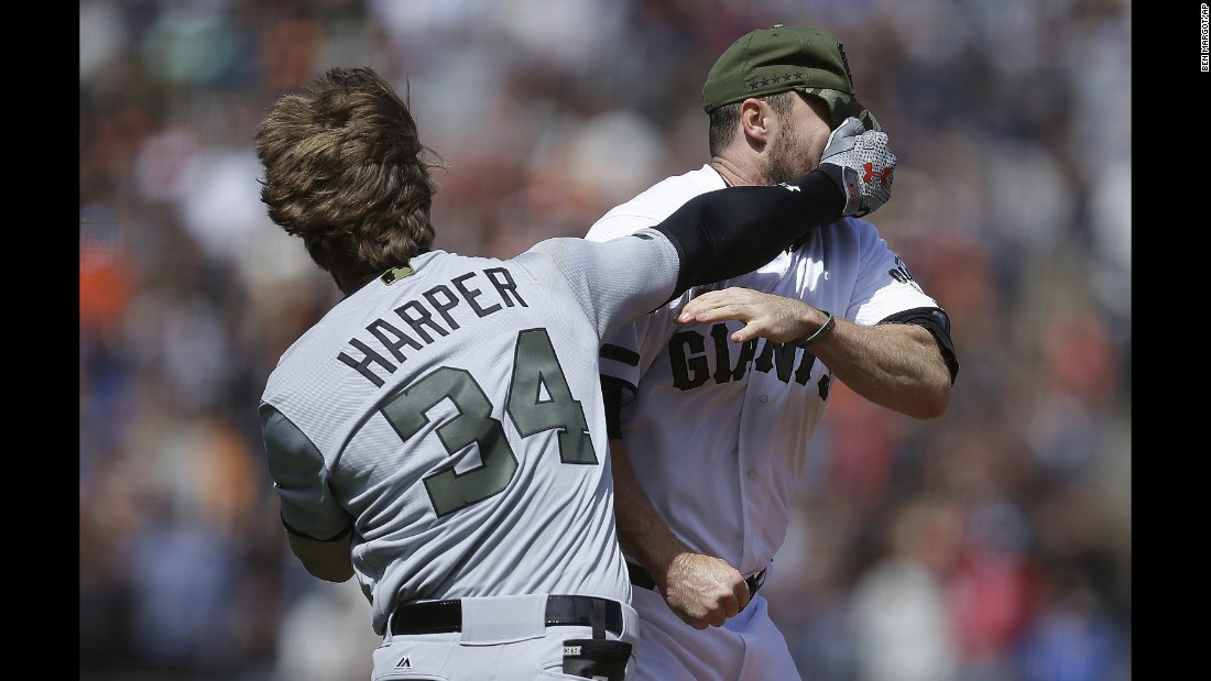 "Washington's Bryce Harper hits San Francisco's Hunter Strickland in the face after being hit with a pitch during a Major League Baseball game in San Francisco on Monday, May 29. Both players were ejected after <a href=""http://bleacherreport.com/articles/2712437-bryce-harper-ejected-after-throwing-helmet-punches-during-bench-clearing-fight"" target=""_blank"">the benches-clearing brawl.</a>"