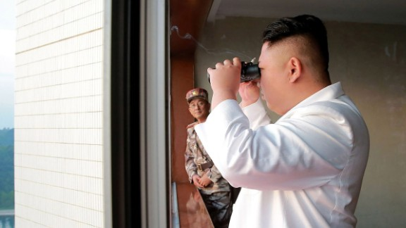This undated photo released by North Korea's official Korean Central News Agency (KCNA) on Tuesday shows Kim Jong Un inspecting a test-fire of a ballistic missile.