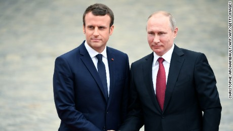 Macron slams Russian news as Putin watches