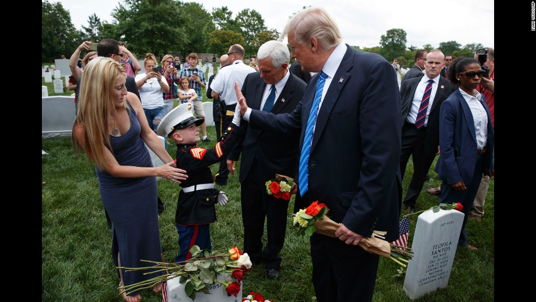 Christian Jacobs, 6, high-fives President Donald Trump near his mother, Brittany, and Vice President Mike Pence as they visited Arlington National Cemetery on Memorial Day. Christian's father, Marine Sgt. Christopher Jacobs, was killed in 2011.