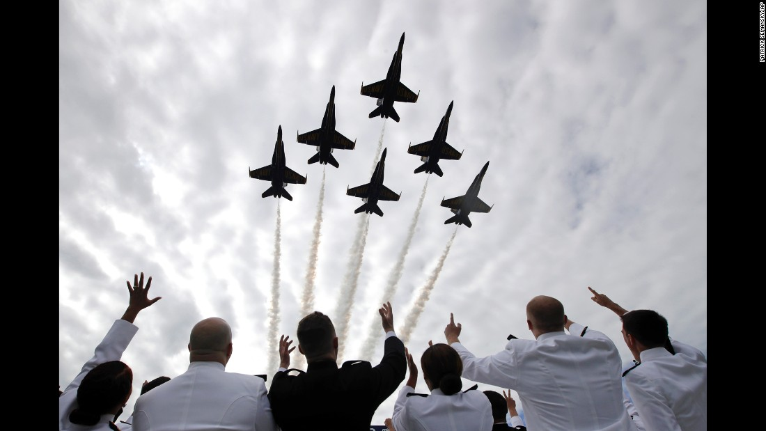 Midshipmen watch the Blue Angels flight team during the graduation ceremony at the US Naval Academy on Friday, May 26.