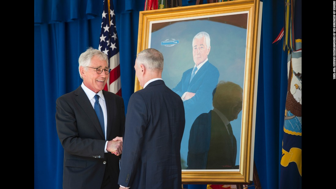 Former Defense Secretary Chuck Hagel, left, shakes hands with current Defense Secretary Jim Mattis as Hagel's official portrait was unveiled at the Pentagon on Friday, May 19. Hagel served from 2013-2015.
