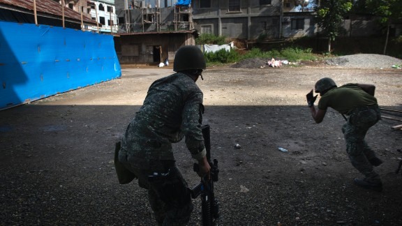 Filipino soldiers engage in a firefight with ISIS-linked militants on May 30, 2017, in Marawi in the southern Philippines.