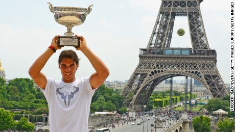 PARIS, FRANCE - JUNE 09: Rafael Nadal of Spain poses with the Coupe des Mousquetaires trophy in front of the Eiffel Tower after his victory against Novak Djokovic of Serbia during day 16 of the French Open at Roland Garros on June 9, 2014 in Paris, France.  (Photo by Frederic T Stevens/Getty Images)
